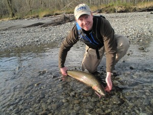 Grant Blinn with a shore caught steelhead about to be released