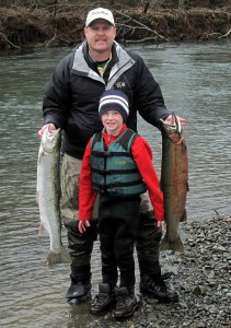 The author, Jason Brooks, with his son Ryan and two winter steelhead on the bank