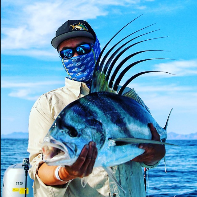 Joe Sarmiento of SoCalSalty.com with a Rooster fish-Gary C Graham photo