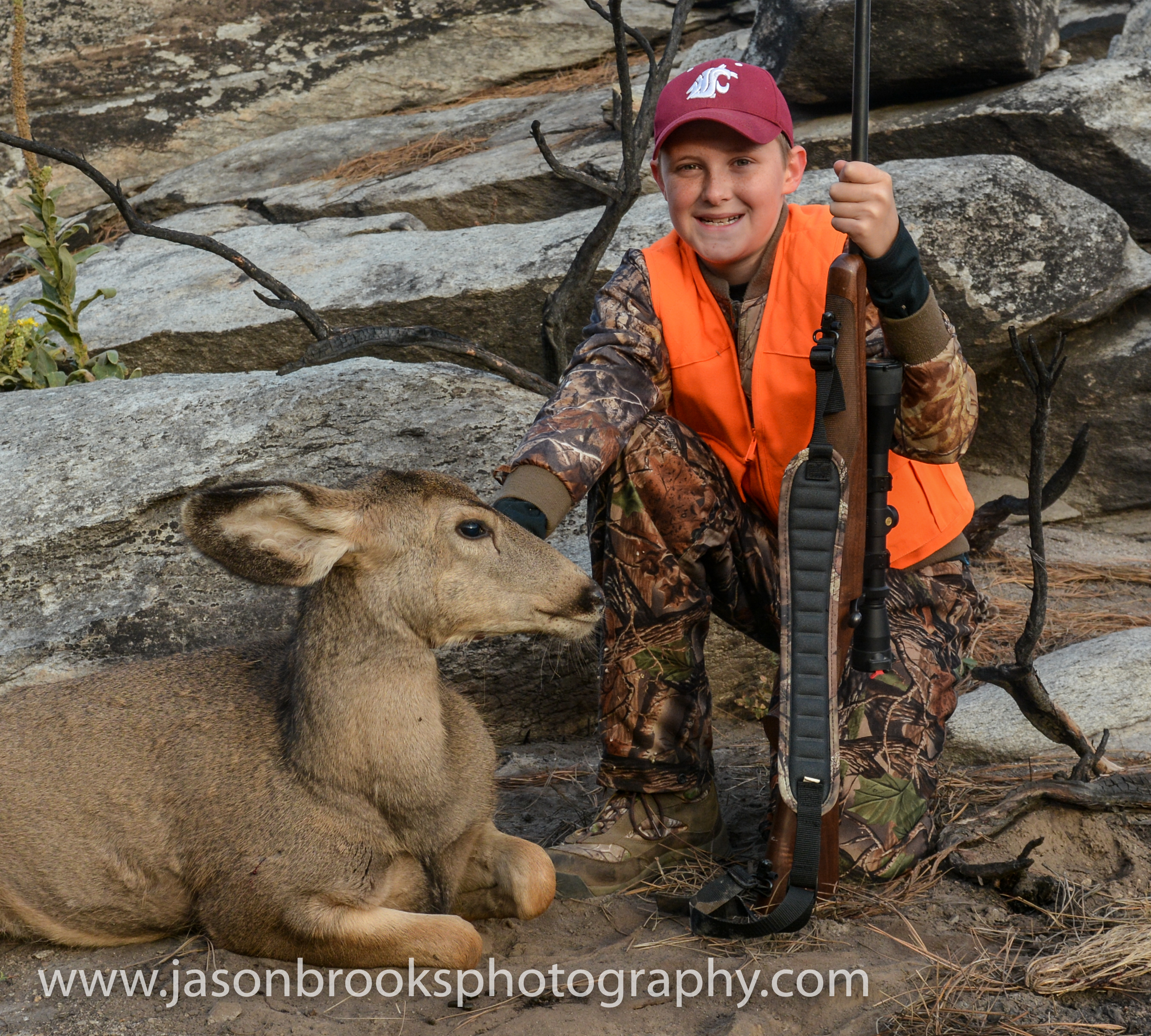 Adam Brooks with his first deer, a muley doe, and a successful hunt-Jason Brooks