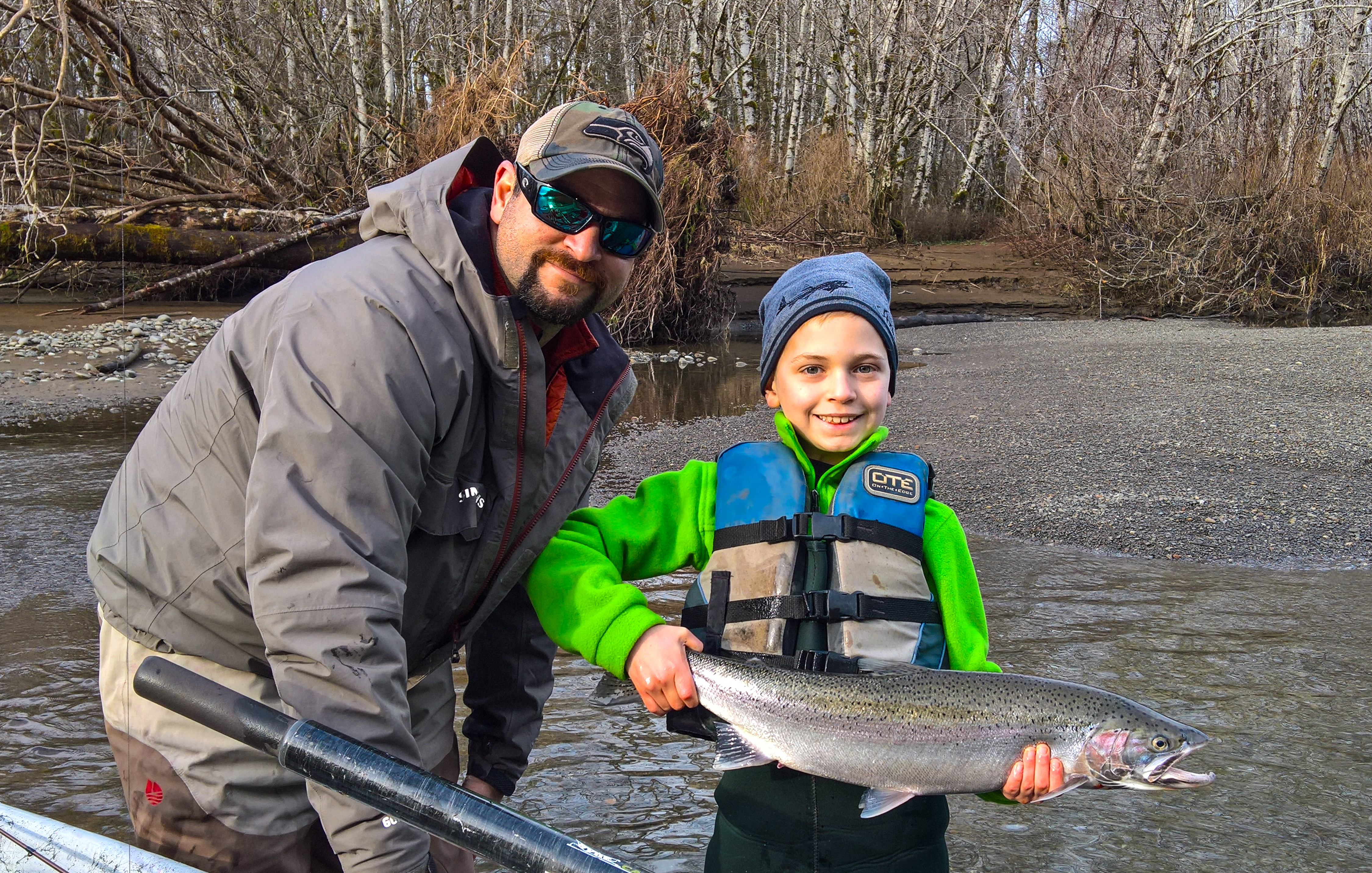 Mike Ainsworth of First Light Guide Service and his son Hunter with a winter steelhead caught bobber dogging-Mike Ainsworth
